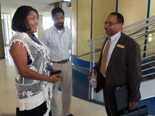 SUSLA Chancellor Rodney Ellis (right) stops to chat