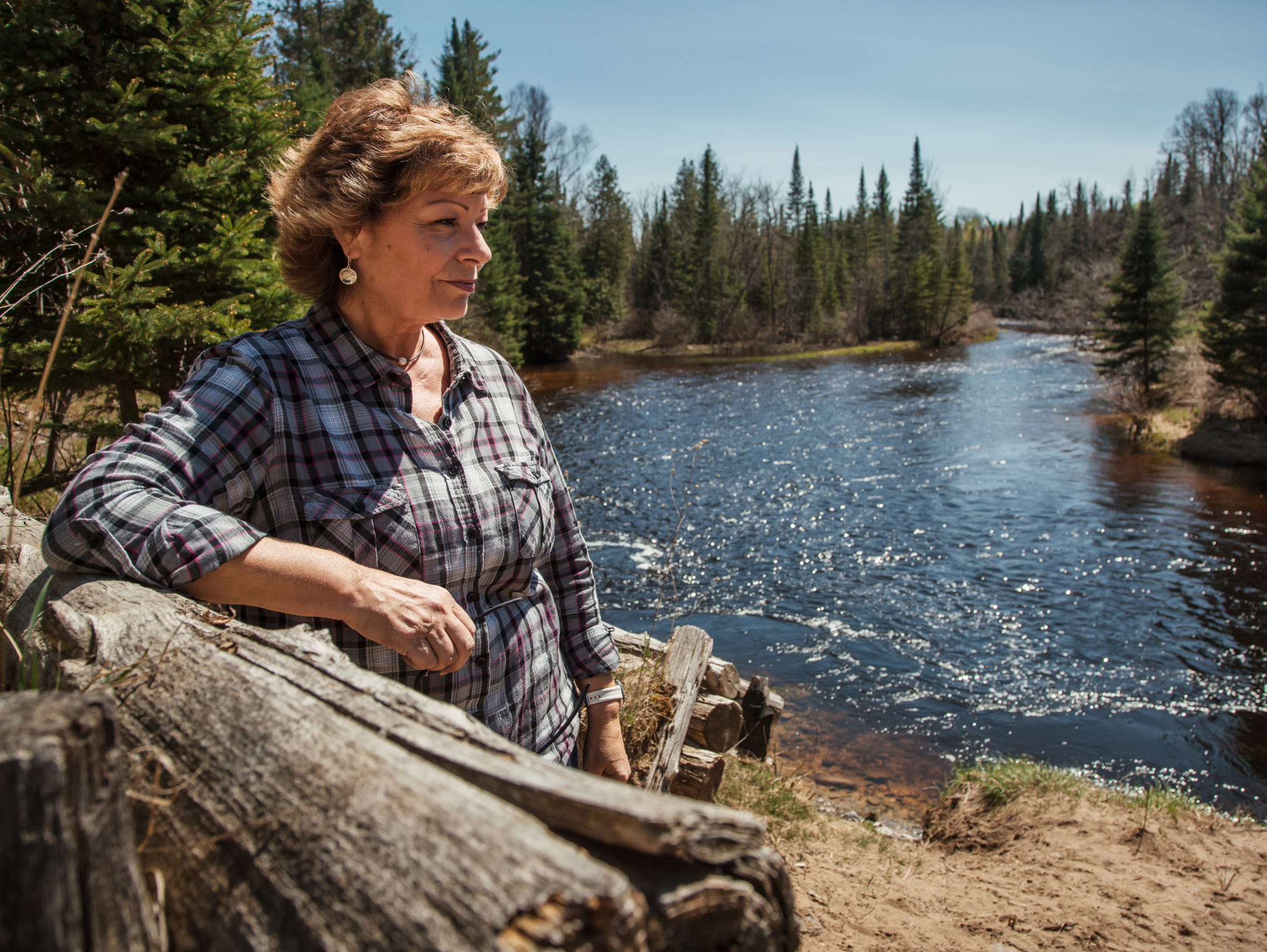 """""""It's just something intrinsic, that it feels good to the soul, and part of it is the experience of being out in nature, but also to know that together we have made a difference in these last 20 years to help this population,"""" said Brenda Archambo, founder of the  Black Lake Chapter of Sturgeon for Tomorrow, while standing along the Black River in Onaway in northern Michigan on Tuesday, May 15, 2018.  Archambo and her organization have made efforts to help restore the Great Lakes' dwindling sturgeon population, spread awareness of the problem and help protect them from poaching."""