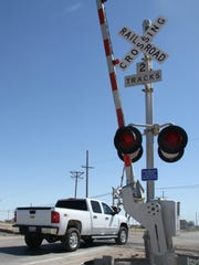 A truck crosses at the railroad crossing at U.S. Highway