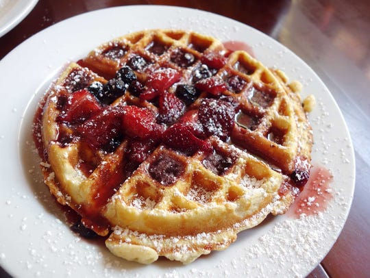 Belgian waffle with warm fruit compote at Alo Cafe.