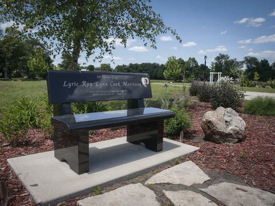 A park bench dedicated to Lyric Cook is part of the