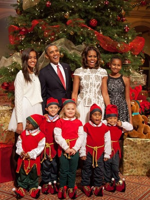 The Obamas pose with elves at the annual Christmas in Washington concert Sunday.