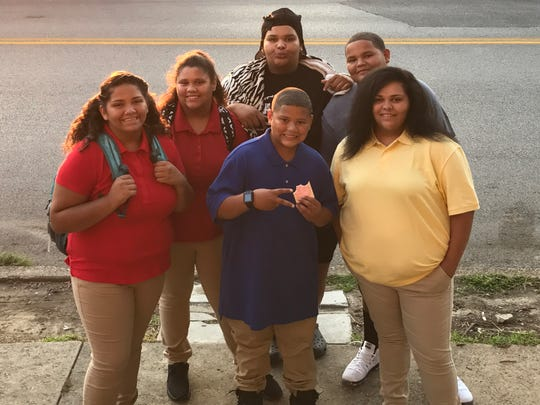 A big crew of Hazelwood's pose before their first day
