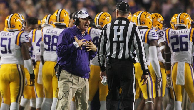 LSU Tigers head coach Les Miles argues with a referee during LSU's game against Arkansas at Tiger Stadium.