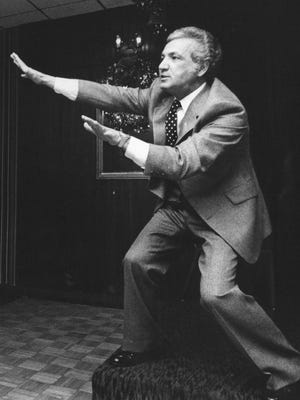 """""""World's greatest salesman"""" Joe Girard stretches to punctuate his point while addressing a group of local real estate salesperson, date unknown."""