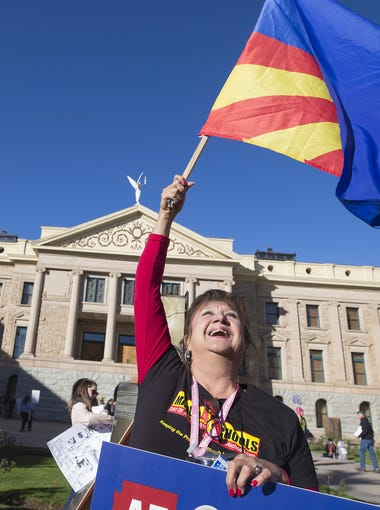Celina Madrid, 17, and her grandmother, Anna Cicero, of Chandler, participate in the Women's March to the Polls 2018 at the Arizona State Capitol in Phoenix on Jan. 21, 2018.