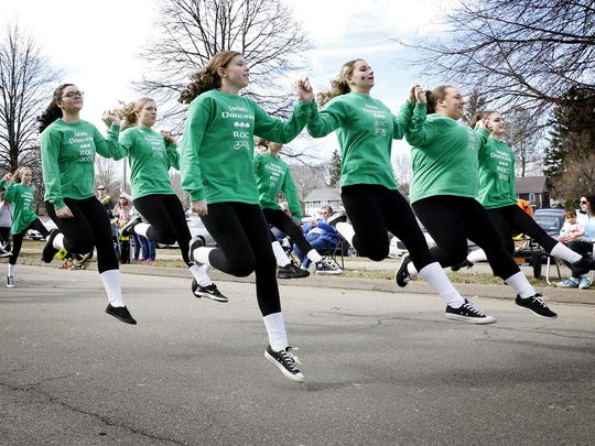 ROC Irish Dancers leap while doing a jig near Horseheads High School last year during the St. Patrick's Day Parade.