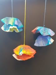 Hanging Chihuli bowls made by Culver Family Learning Center students during Kaleidoscope.