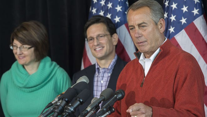 Speaker of the House John Boehner, right,  speaks during the House Republican Leadership news conference in Cambridge, Md., on Jan. 30.  With him are Majority Leader Eric Cantor, R-Va., and Rep. Cathy McMorris Rodgers, R-Wash.