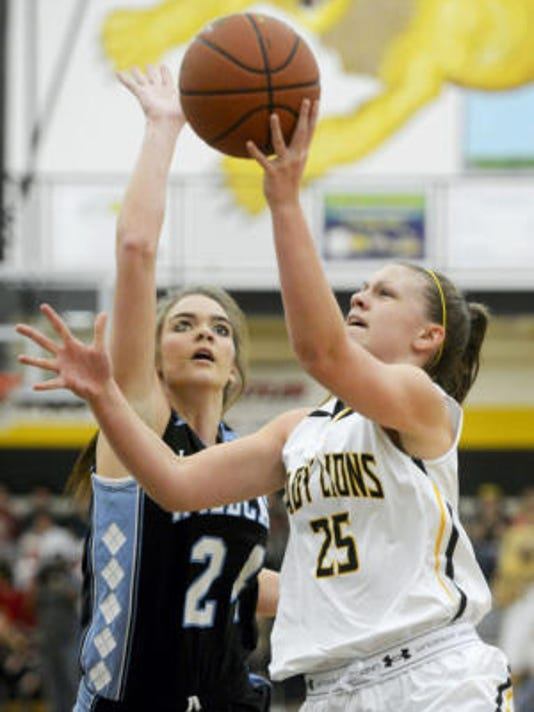 Red Lion's Courtney Dimoff goes to the hoop against Dallastown's Katie McGowan during a girls basketball game Friday at Red Lion Area Senior High School. Dimoff had a game-high 21 points. (Kate Penn -- GameTimePA.com)