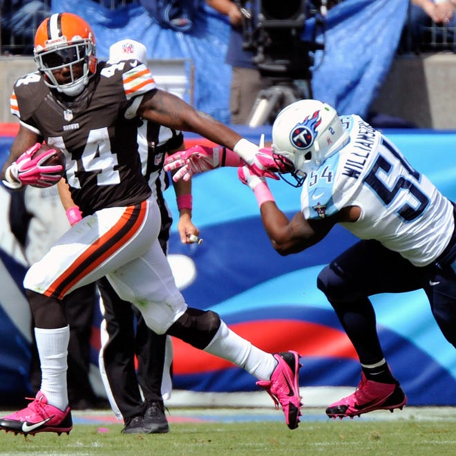 Browns running back Ben Tate gets by Titans rookie linebacker Avery Williamson during last Sunday's game at LP Field.