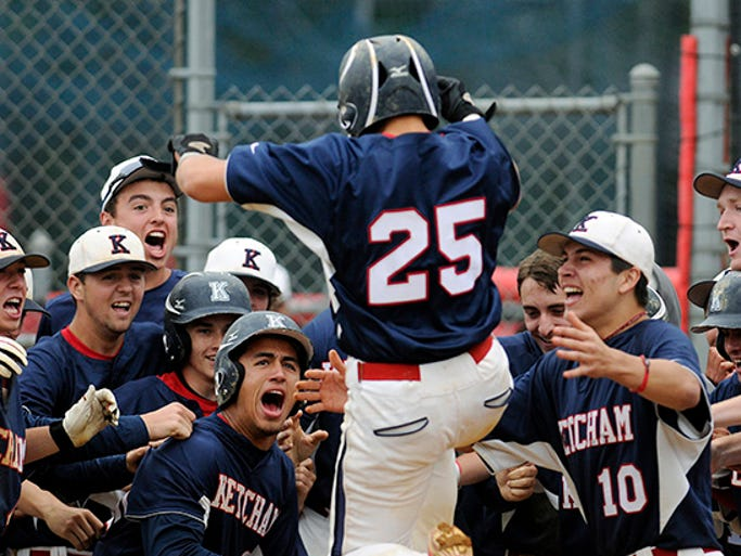 The Ketcham High School baseball team sets to mob teammate Dan Alonzo, center, after he clubbed a grand slam against Arlington on Wednesday in Wappinger. May 28, 2014
