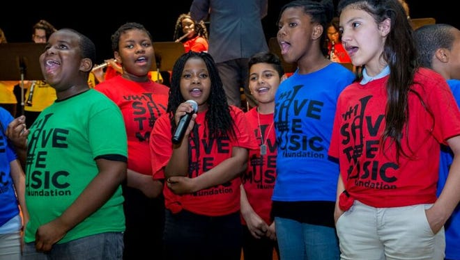 Trenton students participate in a  musical showcase, Thursday, June 9, at the Joyce Kilmer Middle School in Trenton to celebrate the rebuilding of music programs in 14 of the 17 elementary and middle public schools in the city.
