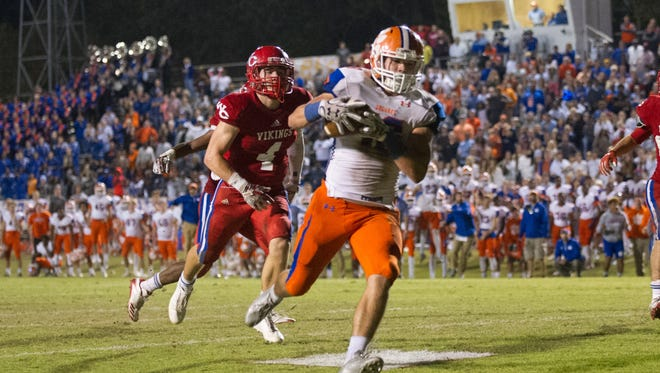 Madison Central's Luke Robertson catches the game winning touchdown pass with only 17 seconds left in the game during the Madison Central vs Warren Central playoff game in Vicksburg.