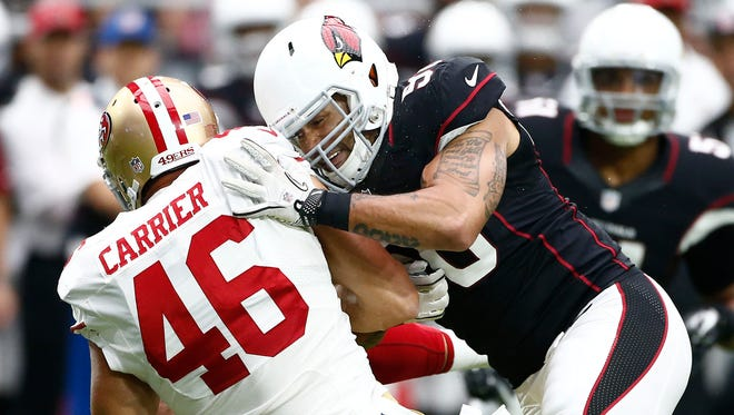 Arizona Cardinals Larry Foote tackles San Francisco 49ers Derek Carrier in the second half on Sunday, Sep. 21, 2014 at University of Phoenix in Glendale.