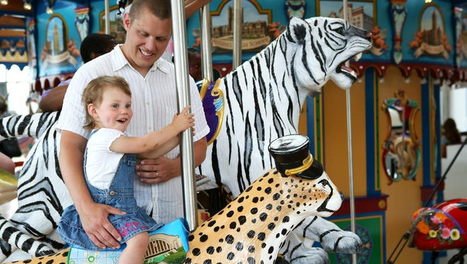Autumn Fun at Carol Ann's Carousel happens Friday from 11 a.m.-3:30 p.m. Pictured: Madelyn and Will Beinkemper ride the Carol Ann's Carousel in Smale Riverfront Park on its opening day Saturday, May 16, 2015.