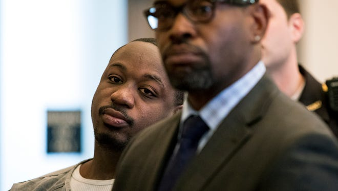 Cornell Beckley (left) listens to Common Pleas Judge Steven Martin, during his arraignment at the Hamilton County Courthouse Tuesday, April 24, 2018. Beckley is scheduled to stand trial next month in connection with the mass shooting at the Cameo nightclub. Beckley, 28, has been accused of paying off witnesses. Court documents say Justin Watson is involved in two of the alleged bribery incidents.