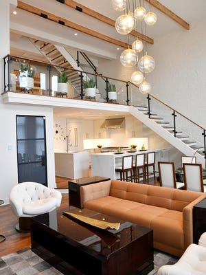The living room inside a  3-bedroom rooftop home at 207 Third Ave N is listed for $3.89 million.Wednesday March 28, 2018, in Nashville, Tenn