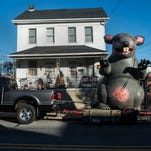 An inflatable rat stands off of North Main Street in Spring Grove on Nov. 16, 2015.