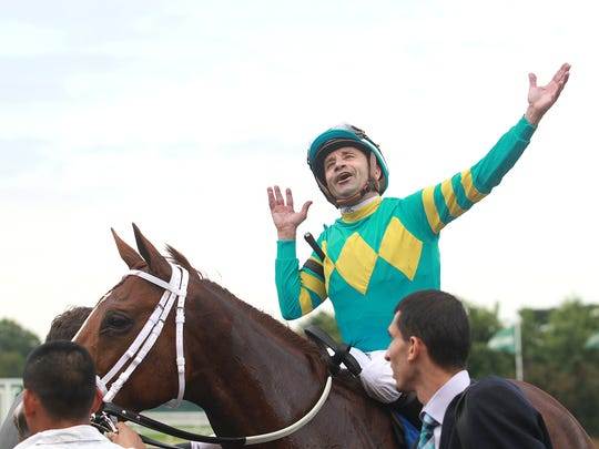 Jockey Joe Bravo reacts after he guided Bigger Picture to  victory in the Grade I $300,000 United Nations Stakes Saturday at Monmouth Park.