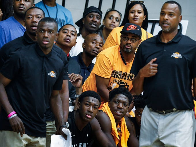 Team Penny fans, coaches and players watch action against