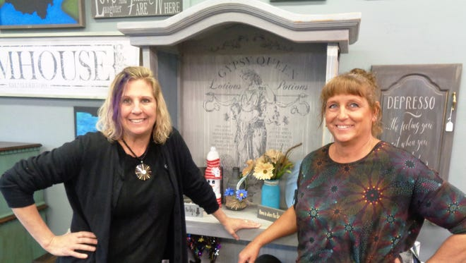 Owner partners Jeanne Duke and Deborah Holwadel of Old is New Antiques and Two Weathered Souls during the grand opening Dec. 1.