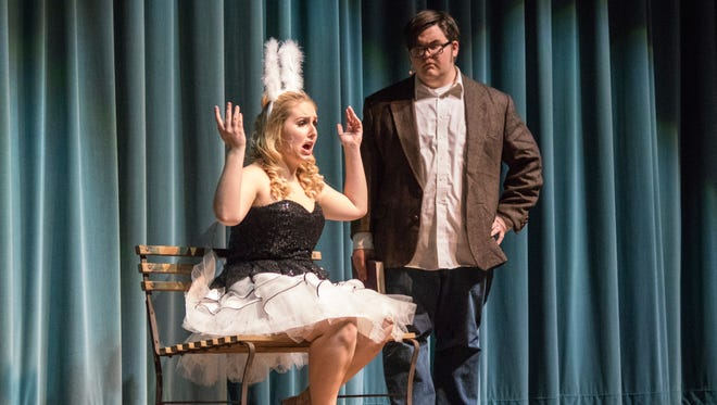 Port Clinton students Laura Helmer, playing the part of Elle, and Blaze Kodak, as Emmett, rehearse a scene for their upcoming musical 'Legally Blonde.'