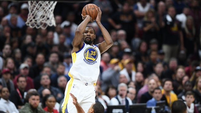 Golden State Warriors forward Kevin Durant (35) shoots against the Cleveland Cavaliers during the second quarter in Game 3 of the NBA Finals.