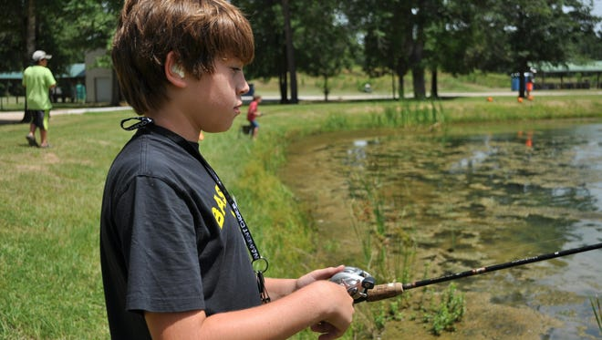 Kids fish Wednesday at the Louisiana Department of Wildlife and Fisheries day camp.