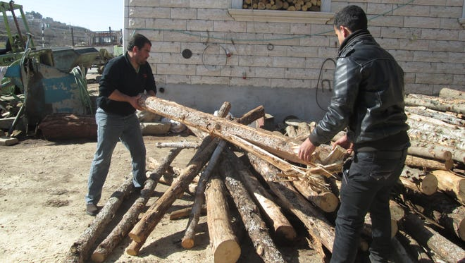 Muataz Shalaldeh, right, and his brother Ashraf say their firewood business is down 90% since September when Palestinians launched a new wave of attacks.