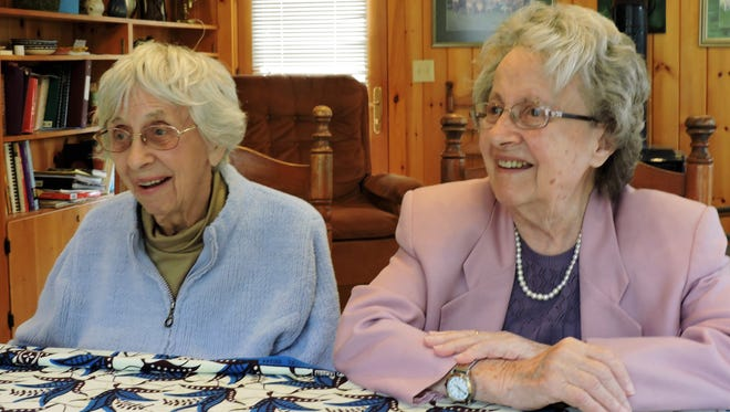 Jacoba Baker, left, and Mary Benson recall growing up in Lansing.