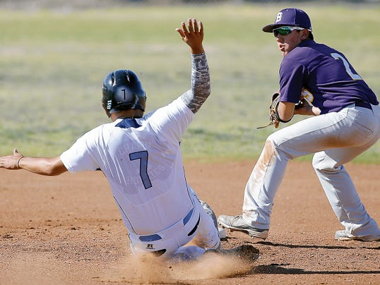 MARK LAMBIE-EL PASO TIMES  Burges short stop Adrian Gomez looks to first base for a double play after getting Chapin's Chris Flores out at second during their game Tuesday at Chapin High School.