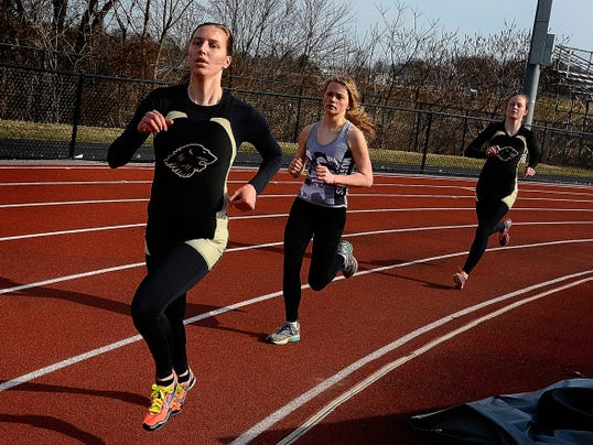Red Lion's Julia Kendrick leads Lauren Hall of South Western and teammate Triston Schulderberg in turn three of the final lap of the girls' 1,600-meter race on Thursday. Kendrick won the race — one of her three individual victories on the day.