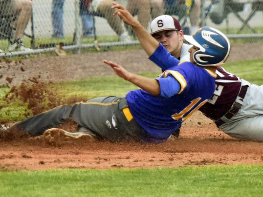 Shippensburg's Nate Reiner (22) gets the tag on Nathan Ocker of Middletown during a first-round District 3 Class AAA baseball game Monday. No 16 Middletown defeated top-seeded Shippensburg 4-1 in nine innings.