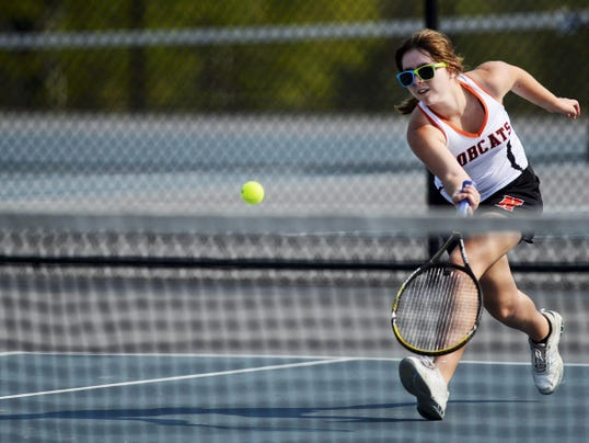 Northeastern's Leah Shaffer runs to hit a return against York Catholic's Annie Javitt (not pictured) during a tennis match Tuesday at Springettsbury Township Park.