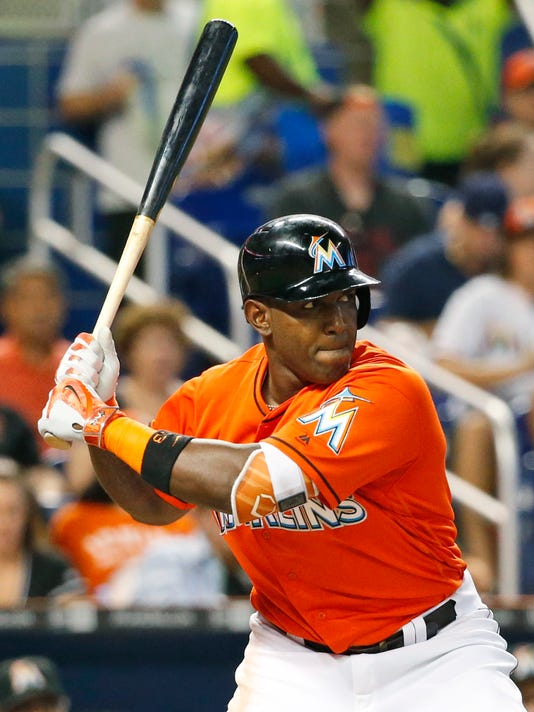 Miami Marlins center fielder Marcell Ozuna bats during the fifth inning of a baseball game against the Cincinnati Reds, Sunday, July 10, 2016, in Miami. In the past year Ozuna has gone from minor league exile to the starting lineup in the All-Star Game, and he credits Barry Bonds for the turnaround. (AP Photo/Wilfredo Lee)