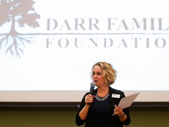 Heather Zoromski, executive director of the Darr Family Foundation, announces a $1,010,000 award to the Community Partnership of the Ozarks Every Child Promise on Friday.