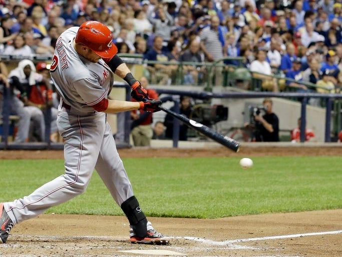 Cincinnati Reds' Zack Cozart hits a single.