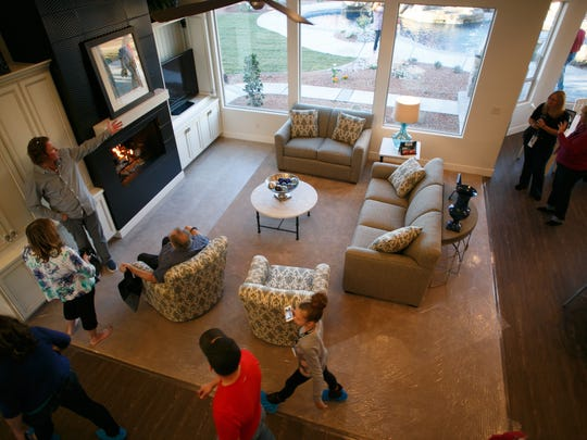 "Builder Riley Richardson, at left, talks with visitors to the St. George Area Parade of Homes entry called ""The True Home"" as they look through great room in the home Friday on the opening day of the 2015 parade."