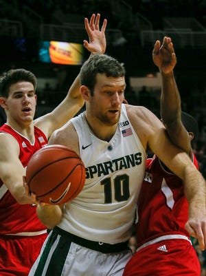 Michigan State's Matt Costello is double-teamed by Nebraska's Michael Jacobson and Glynn Watson Jr. during MSU's loss Wednesday at the Breslin Center.