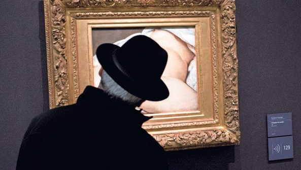 "A visitor looks at Gustave Courbet's 1866 ""The Origin"