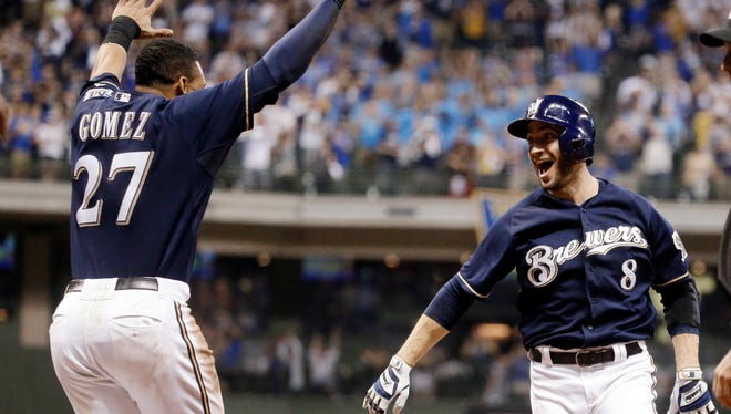 Milwaukee Brewers' Ryan Braun reacts after hitting a game-winning single during the ninth inning of a baseball game against the Colorado Rockies Friday.