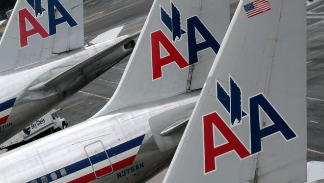 An American Airlines passenger was grounded Tuesday after he became upset with flight attendants who wished him a Merry Christmas.