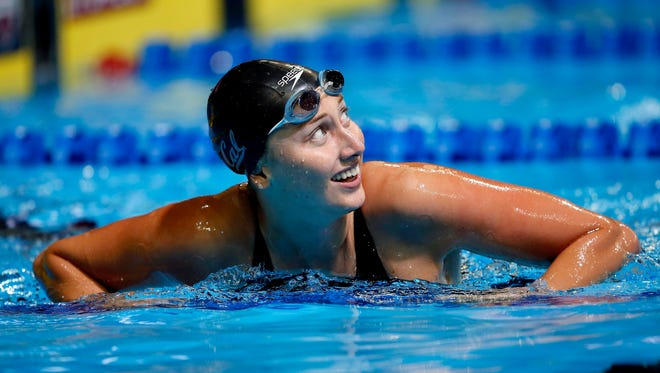 FILE -- Amy Bilquist reacts after the women's backstroke 100m semi-finals in the U.S. Olympic swimming team trials at CenturyLink Center.