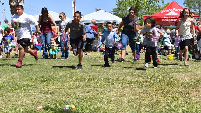 Kids sprint in search of Easter eggs at the 2017 Easter in the Park.