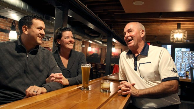 2Fog's owner Joe Parker, right, shares a laugh and a drink with daughter Courtney Tarara and son-in-law Fabrizio Tarara before opening time May 3, 2017.