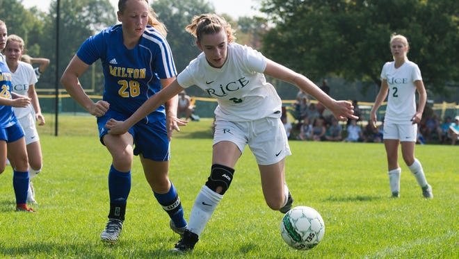 Rice's Sadie Vincent (3) and Milton's Emily Pallas (28) chase down the ball during the girls soccer game between the Milton Yellow Jackets and the Rice Green Knights at Rice High School on Saturday morning September 16, 2017 in South Burlington.