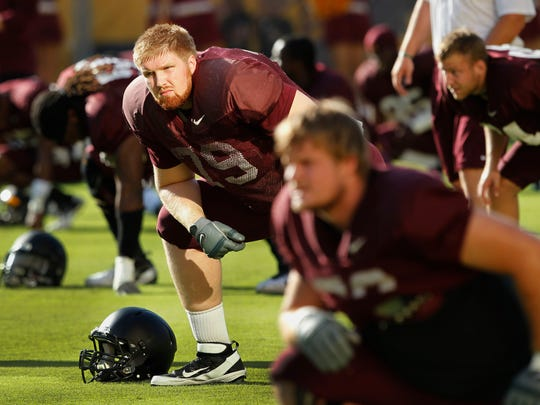 Arizona State's Chip Sarafin stretches during practice Saturday, Aug. 20, 2011 in Tempe.