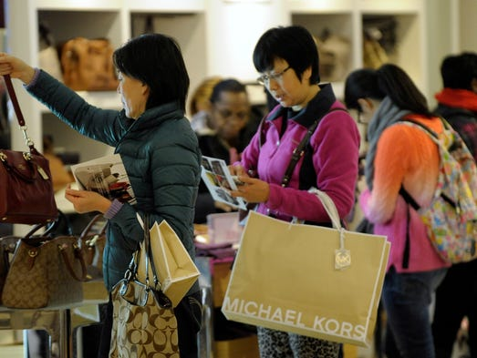 People shop at the Coach Factory at Great Lakes Crossing