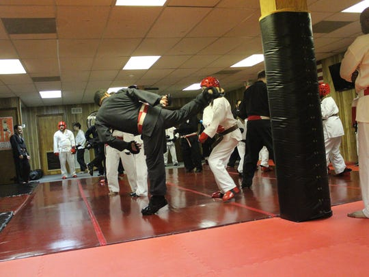 Anthony Netta, recently promoted to 8th Degree Black Belt within the Isshin Shorin Ji Ryu Okinawa Te karate system, demonstrates techniques at his dojo, Netta's Martial Arts in Carteret